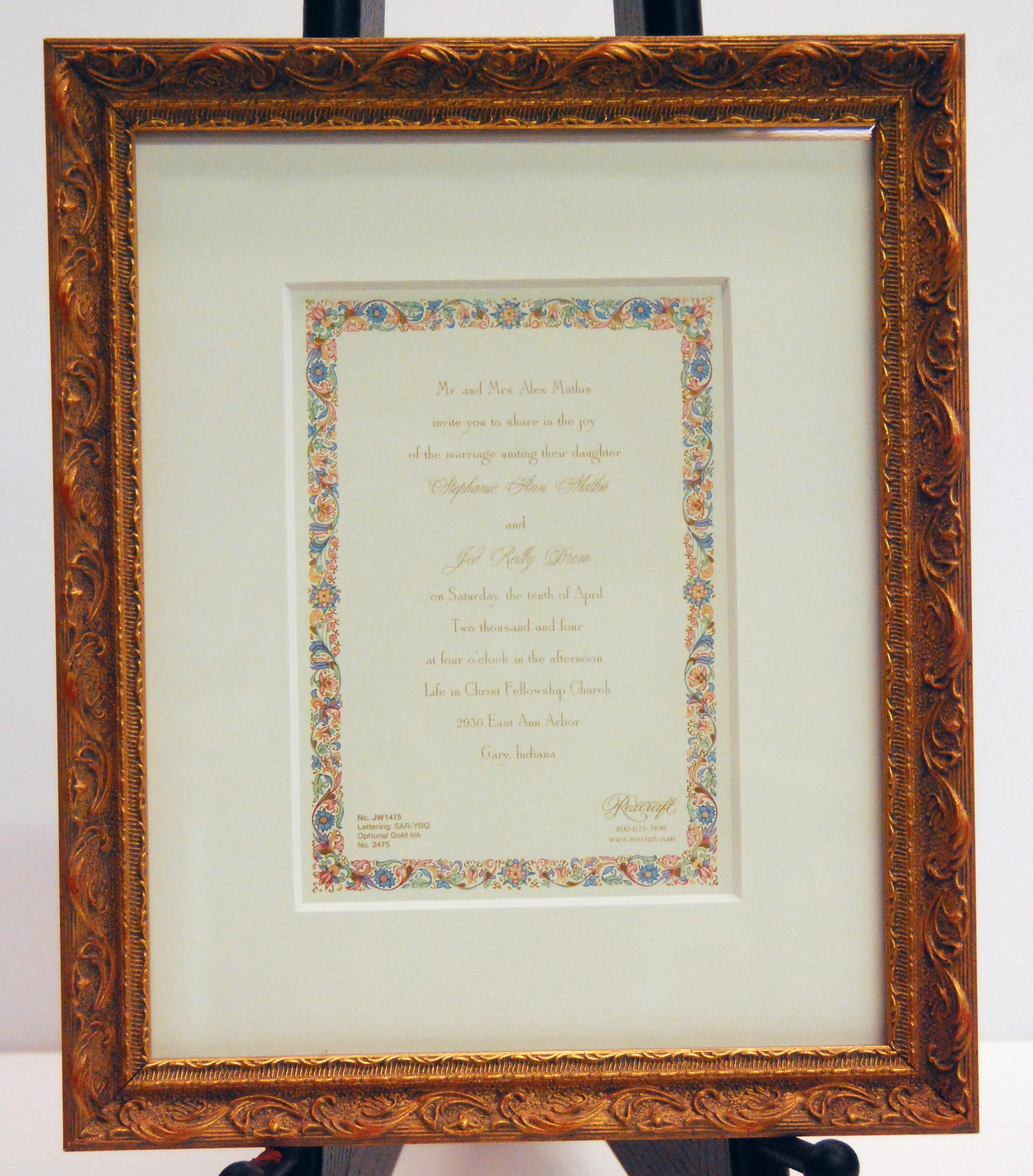 wedding invitation in custom picture frame with several layered mattes