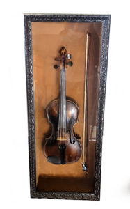 old violin in shadowbox picture frame